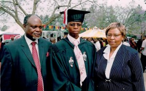 Mzwandile (centre) with his mother and father at his graduation in 2007