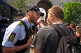 Activist discussing with police officer outside the Danish parliament